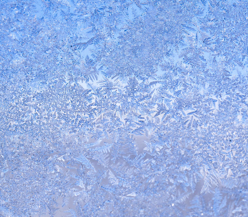 Icy Frost on winter morning. Frosty winter background photo of ice buildup on a window royalty free stock images