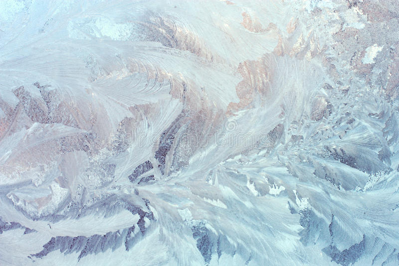 Icy frozen pattern on glass. Winter background royalty free stock images