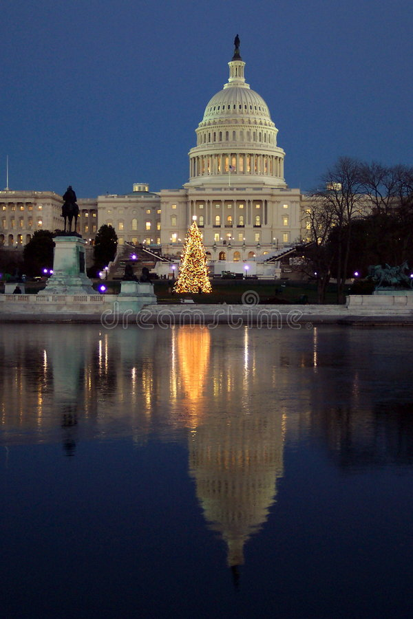 Icy Reflection. Photo of the U.S. Capitol in Washington D.C. and reflecting pool during Christmas time. Some ice has started to form stock photography