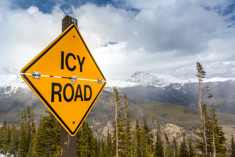 Icy Road Sign. In Rocky Mountains National Park, Colorado, USA stock photography