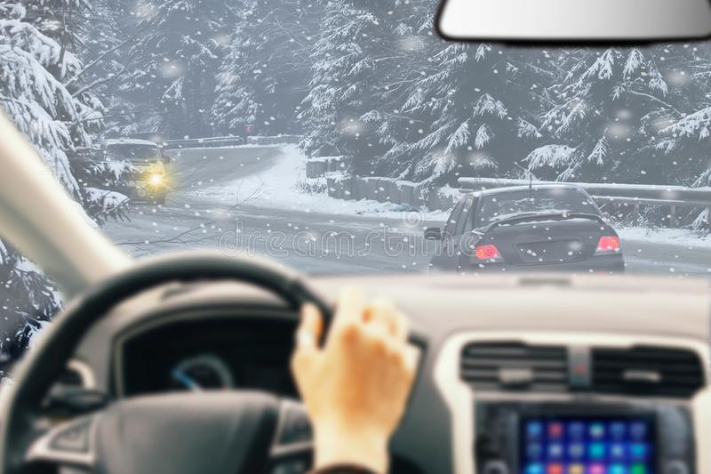 Icy Road Winter Drive. Winter Conditions on the Road with forest. Driver View stock images