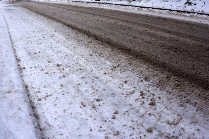 Icy road in winter slush dirt royalty free stock photo