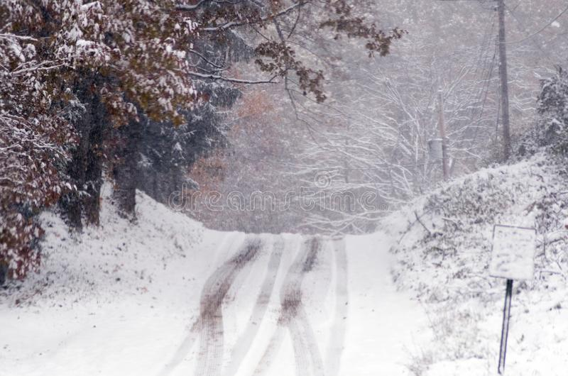 Icy roads during an early snow storm royalty free stock photo