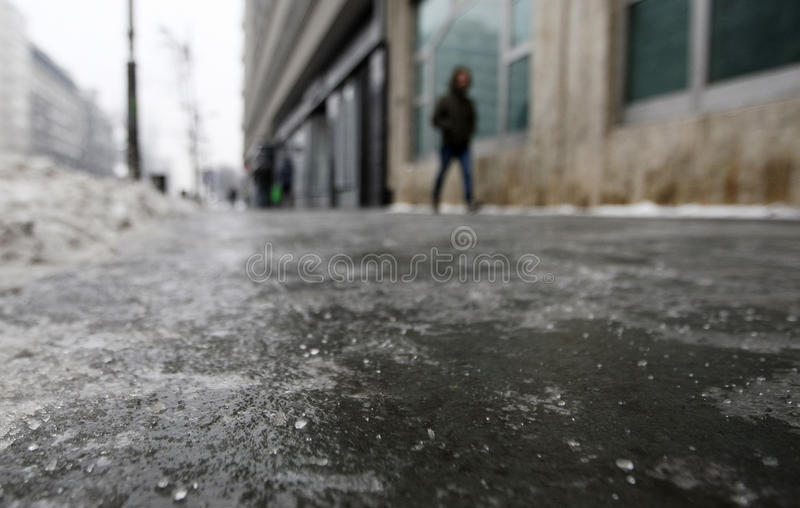 Icy sidewalk on a cold winter day stock photography