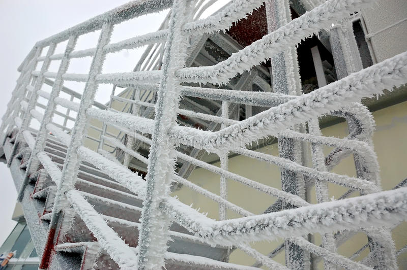 Icy staircase. Hand-rail in hoar-frost, frosty industrial landscape stock images