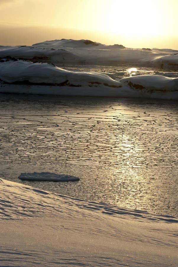 Icy strait between the islands of the Antarctic night.