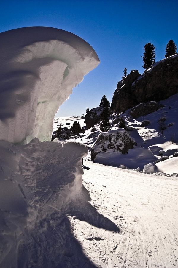 Icy winter view. A bright sunny day in the Dolomites, Italy, with deep snow on wave form nearby Sella pass royalty free stock photos