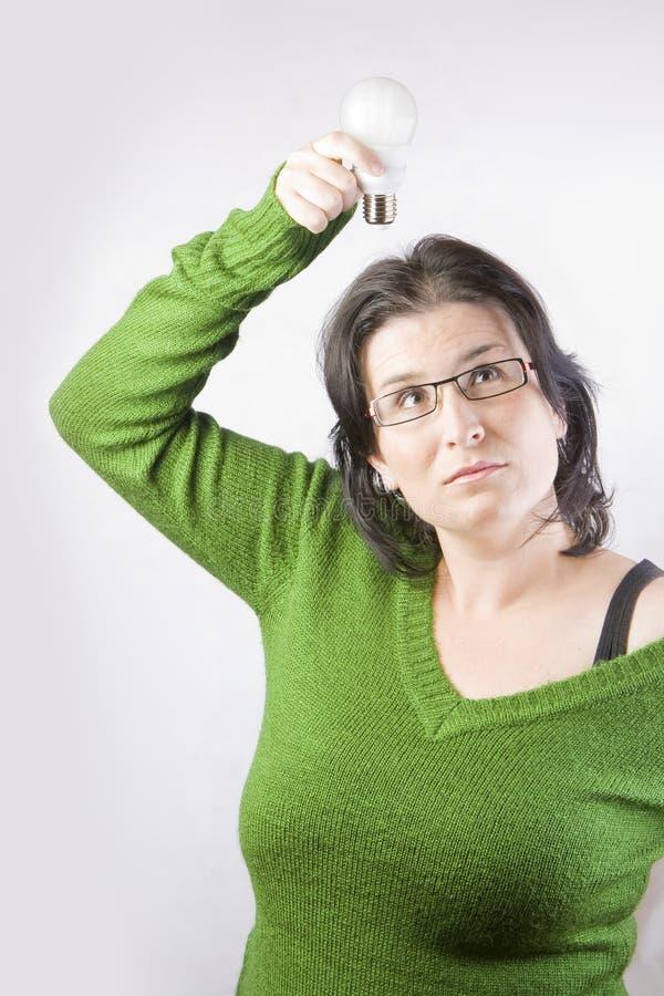 Idée d'ampoule de femme photo libre de droits