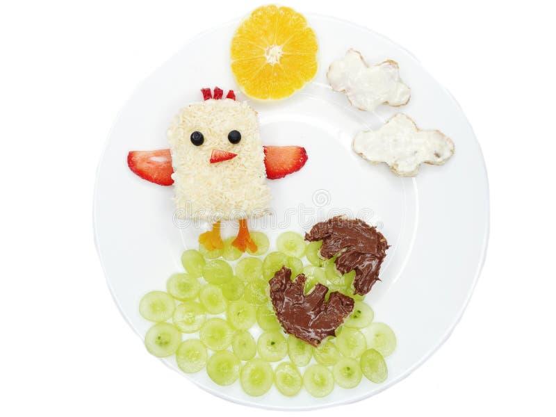 Idérik frukost med kräm för frukt och för söt choklad på bröd royaltyfria foton