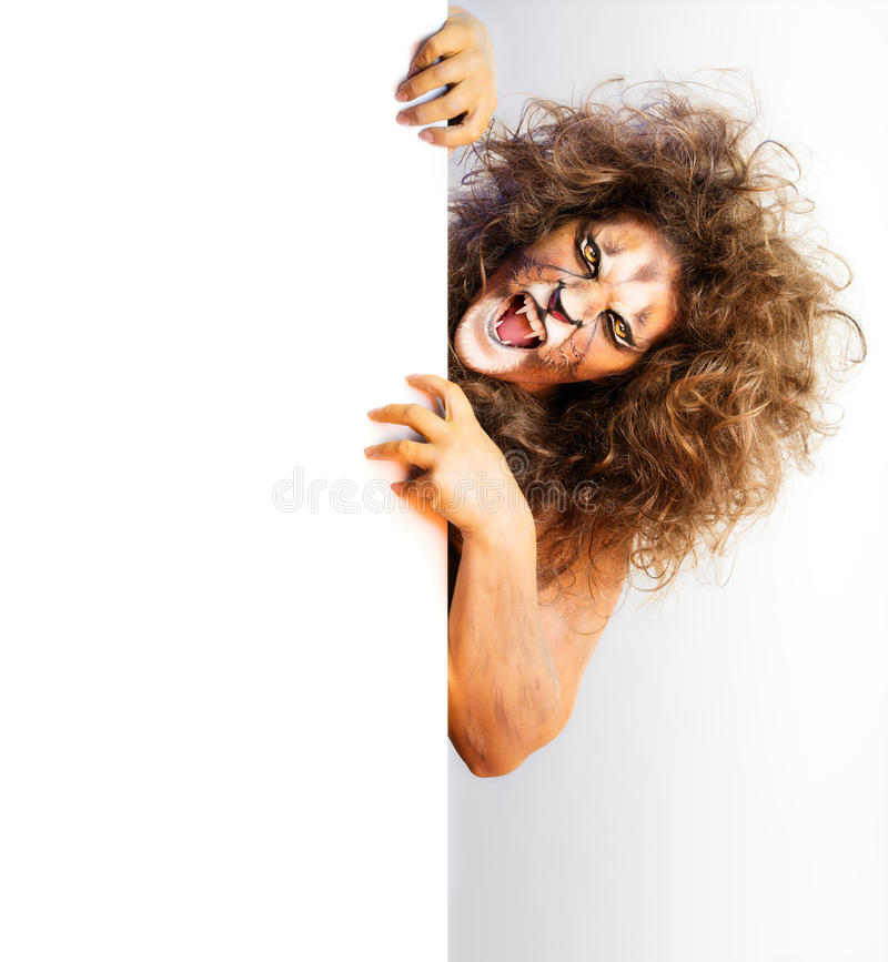Idérik kroppmålning - Lion Showing fotografering för bildbyråer