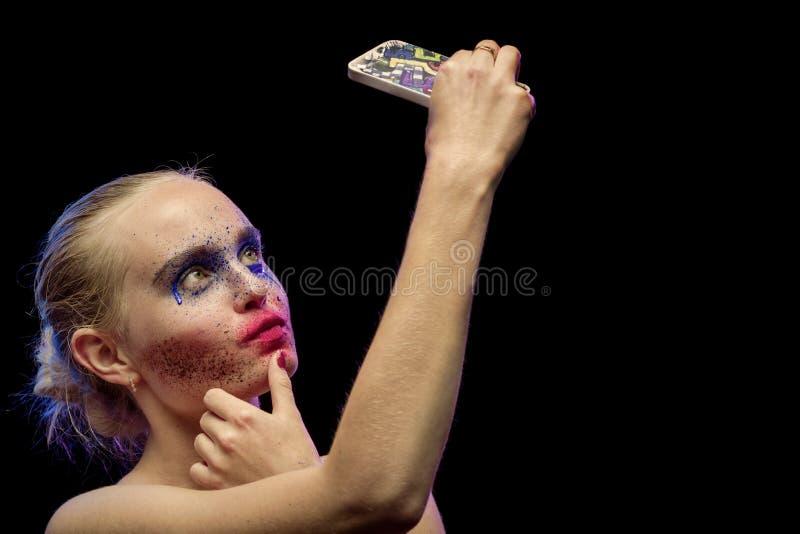 Idérik mångfärgad makeup fotografering för bildbyråer