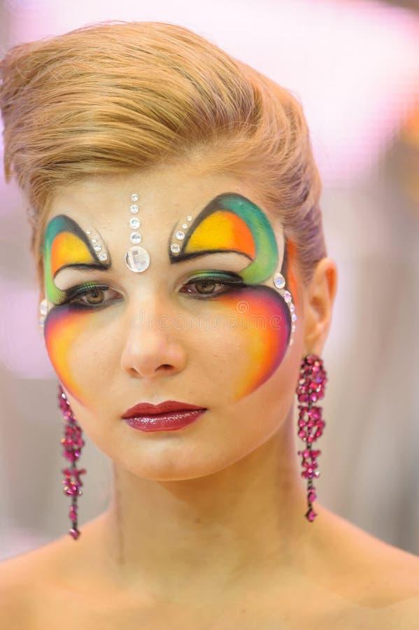 Idérik makeupshow på festivalen av skönhet royaltyfria bilder