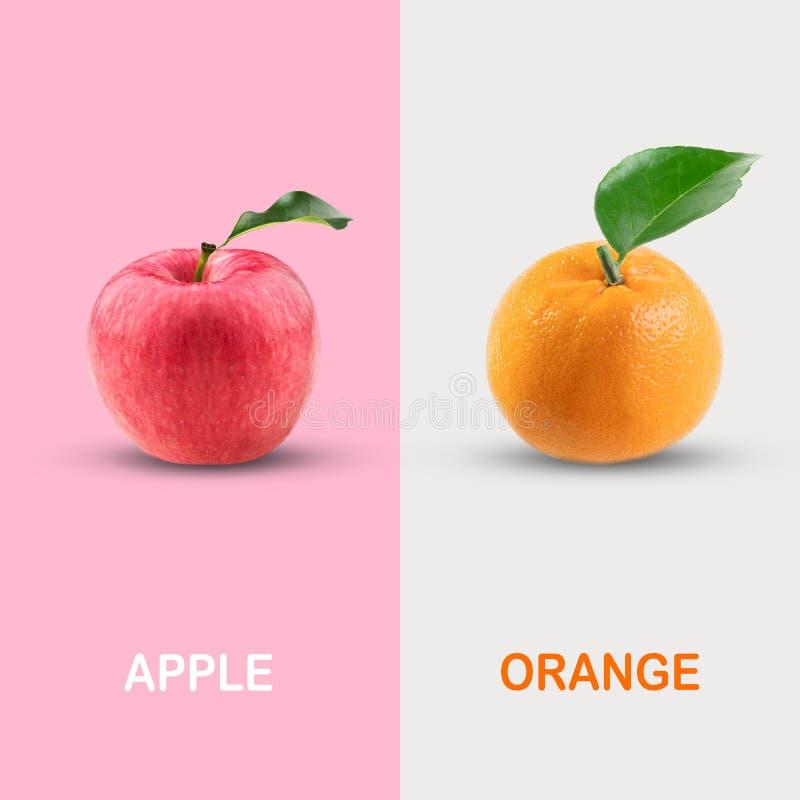 Idérik orientering som göras av det röda äpplet och apelsinen arkivfoton