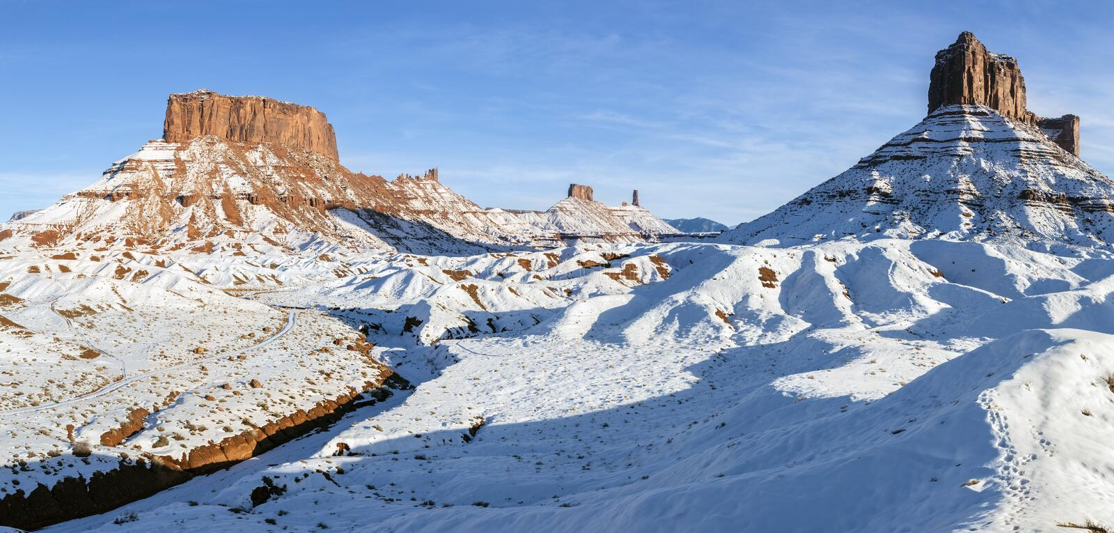 Ida Gulch and Castle Valley Mesas in Snow. A Panoramic image of the mesas and towers in Castle Valley on a snowy day near Moab, Utah stock images