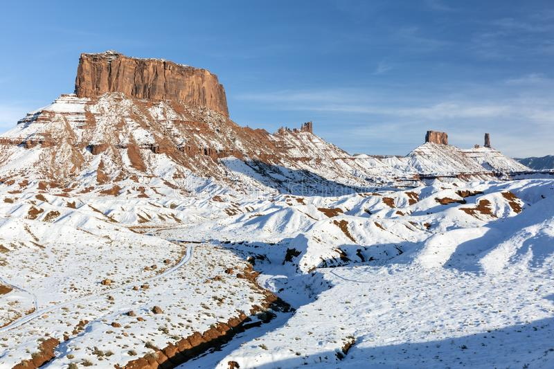 Ida Gulch and Snowy Castle Valley Mesas. A Panoramic image of the mesas and towers in Castle Valley on a snowy day near Moab, Utah royalty free stock photos