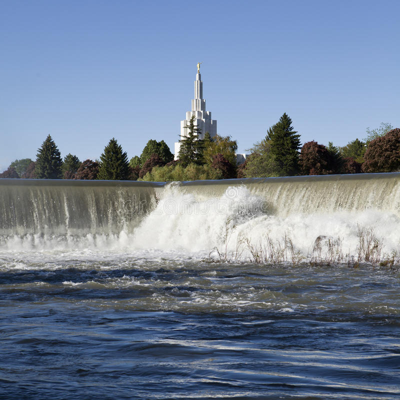 Idaho Falls Landmark. A view of one of the landmark buildings in Idaho Falls looking over the waterfall cascading over the concrete dam royalty free stock images
