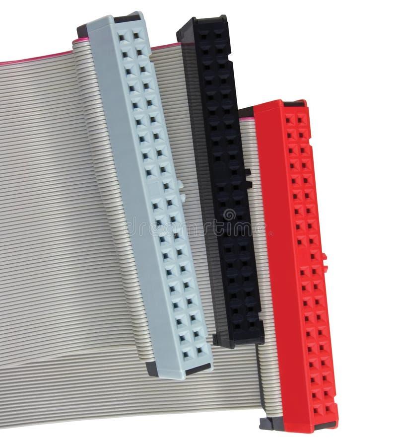 IDE连接器和带形电缆坚硬硬盘驱动器的在个人计算机计算机,被隔绝,红色,灰色,黑色,宏观特写镜头上驾驶 库存照片