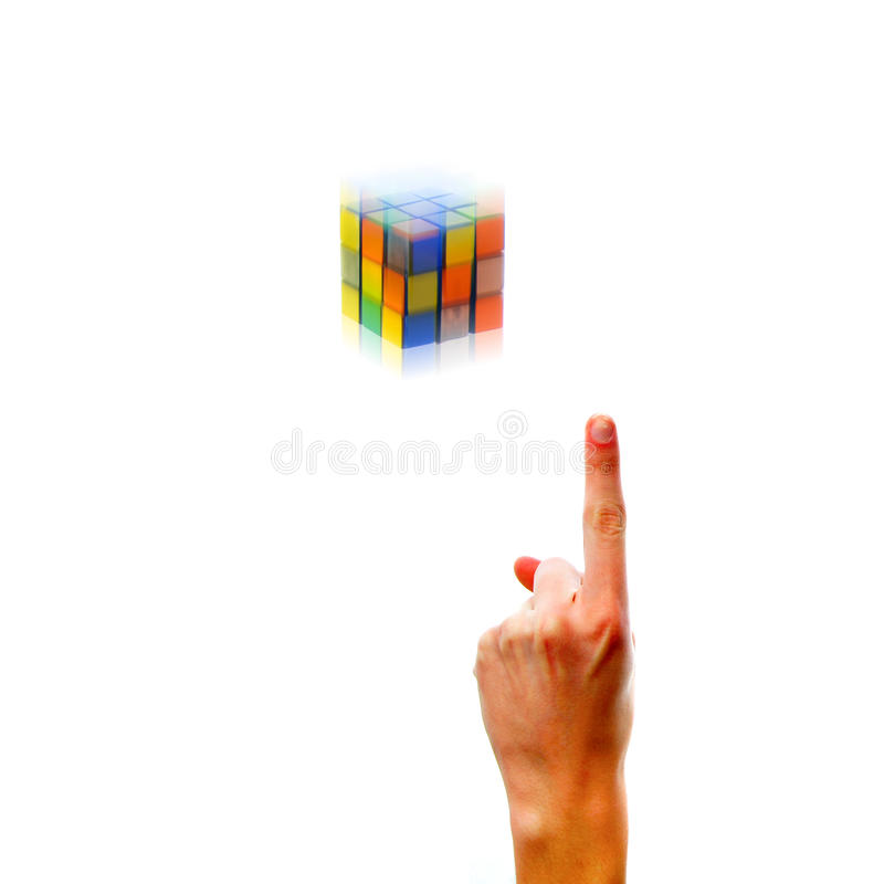 The Idea. Puzzle cube isolated on white background with white Caucasian hand pointing upwards. You must contact Seven Towns Ltd for permission prior to any use royalty free stock images