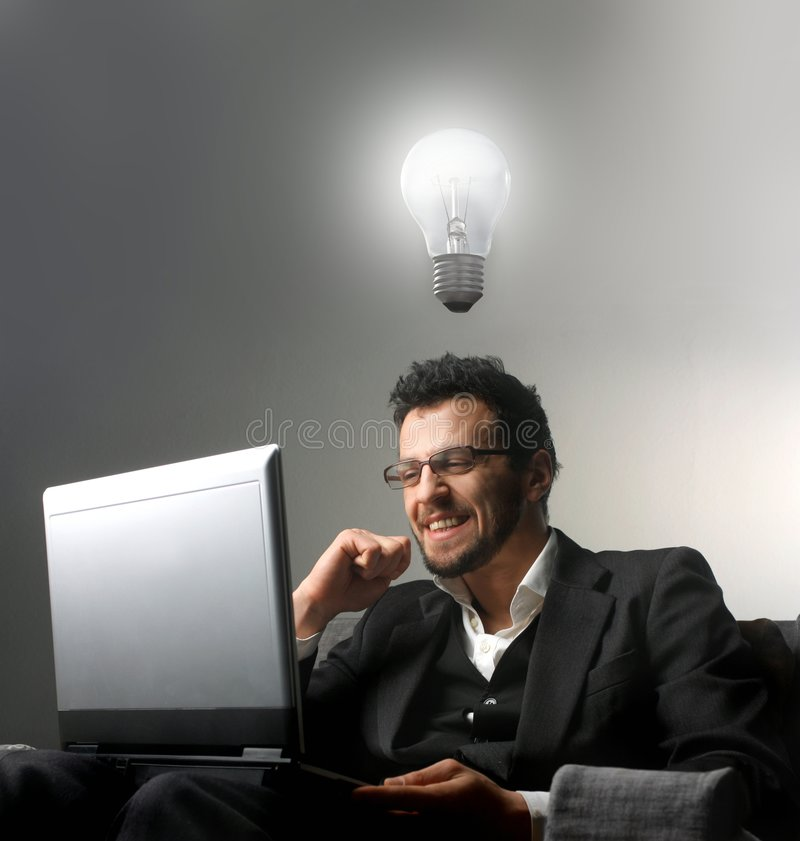Idea. Young businessman using a laptop and having an idea