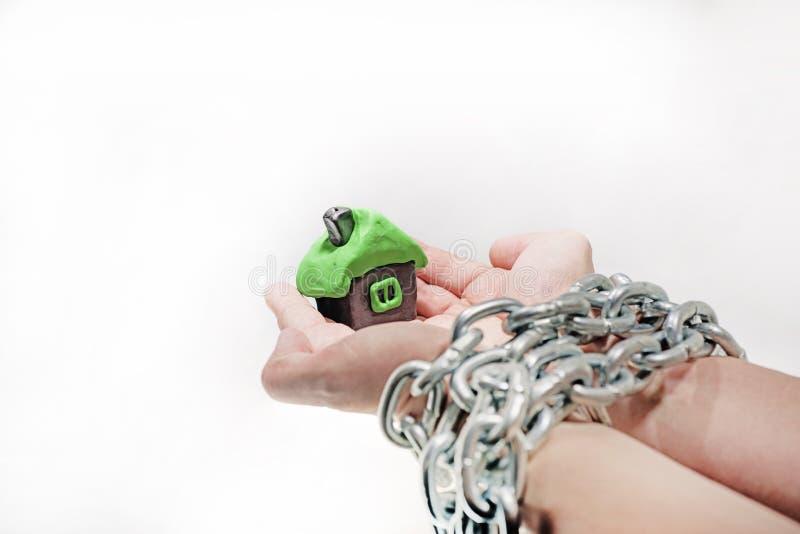 Idea abstracta de la propiedad y de créditos Problemas con la propiedad, casa, dinero foto de archivo