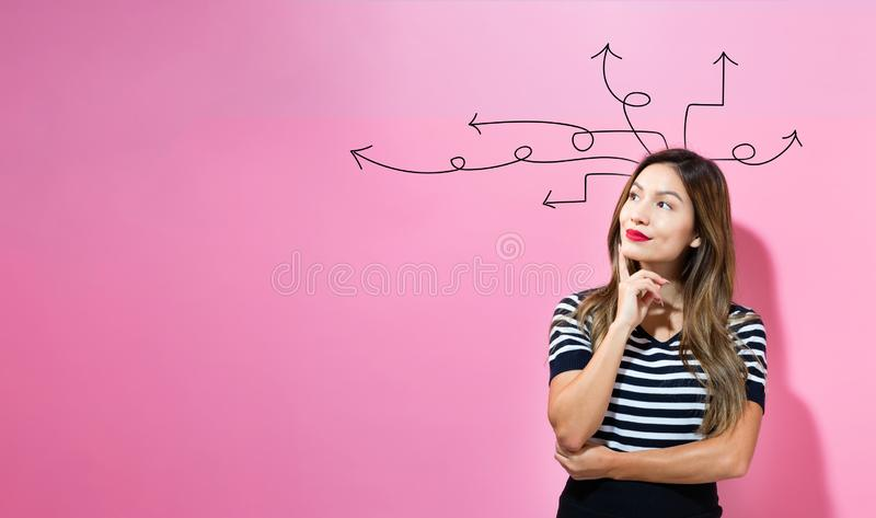 Idea arrows with young businesswoman. In a thoughtful face stock photos