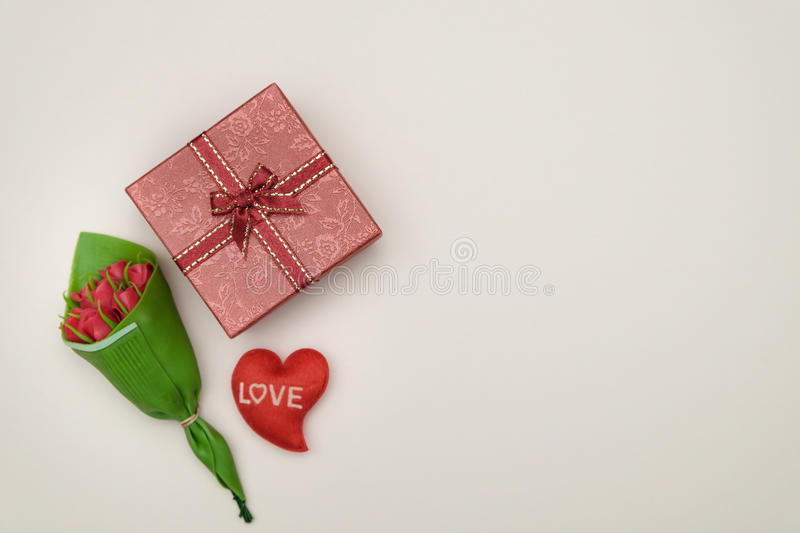 Idea. Bouquet of roses and gift box on yellow background with valentine concept, copy space for write royalty free stock image