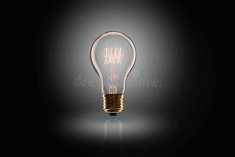 Idea concept -   light bulb on the black background. Idea concept -  incandescent light bulb on the black background lightbulb leadership yellow lamp design stock photo