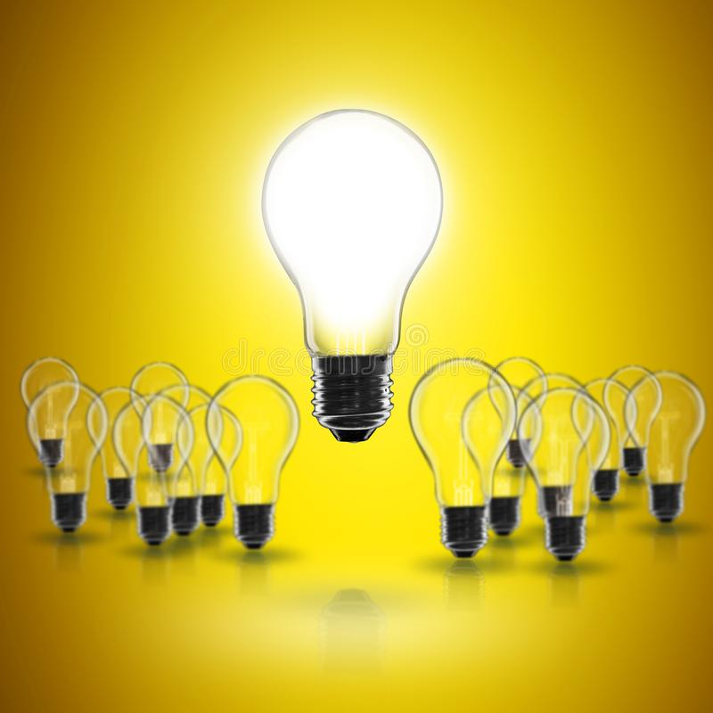 Idea concept -   light bulb on the black background. Idea and  leadership concept -  incandescent light bulb on the black background lightbulb teamwork lamp royalty free stock photos