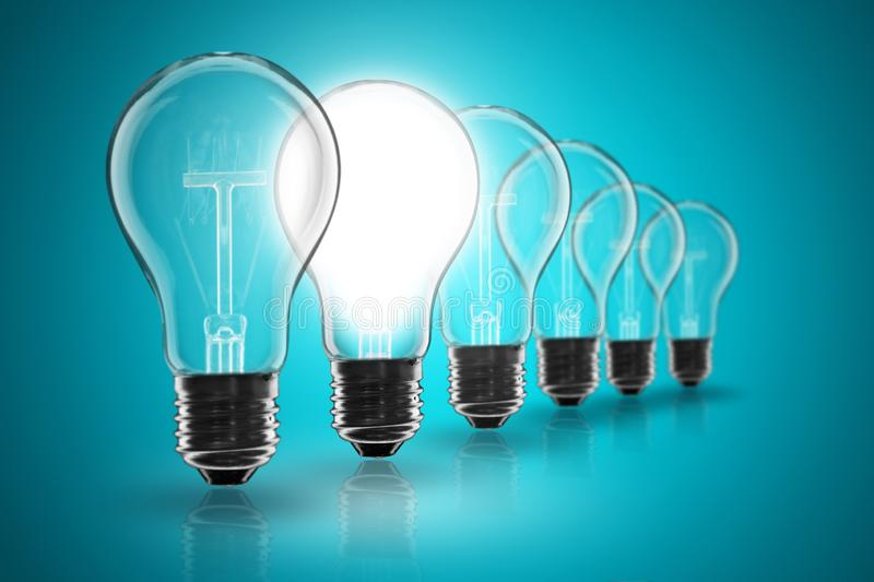 Idea concept -   light bulb on the black background. Idea and  leadership concept -  incandescent light bulb on the black background lightbulb teamwork lamp royalty free stock photography