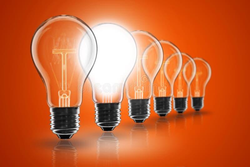 Idea concept - light bulb on the black background. Idea and leadership concept - incandescent light bulb on the black background royalty free stock photography