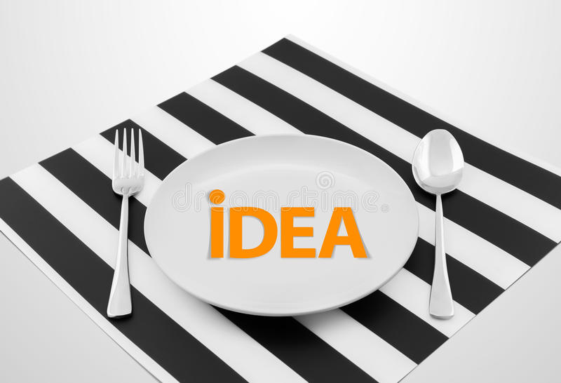 Idea concept on ready to serve dish with spoon and fork stock photos