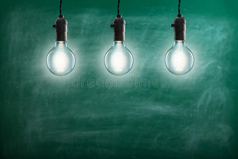 Idea concept - Vintage incandescent bulbs on blue background. Idea concept -  incandescent bulbs on blue background, light, lightbulb, lamp, design, electricity stock images