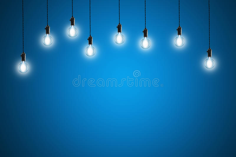 Idea concept - Vintage incandescent bulbs on blue background. Idea concept - incandescent bulbs on blue background stock photography