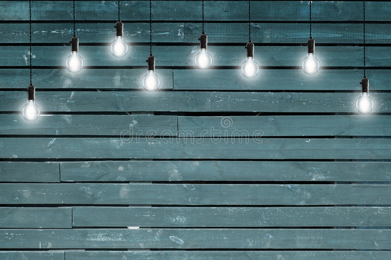 Idea concept - Vintage incandescent bulbs on blue wooden wall. Vintage incandescent bulbs on blue wooden wall stock image