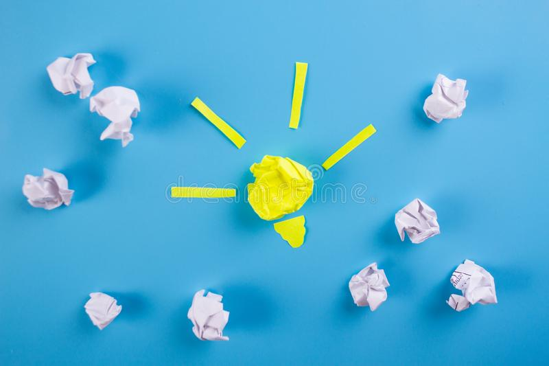Idea Concepts Light Bulb with Crumpled Paper. On Blue background stock image