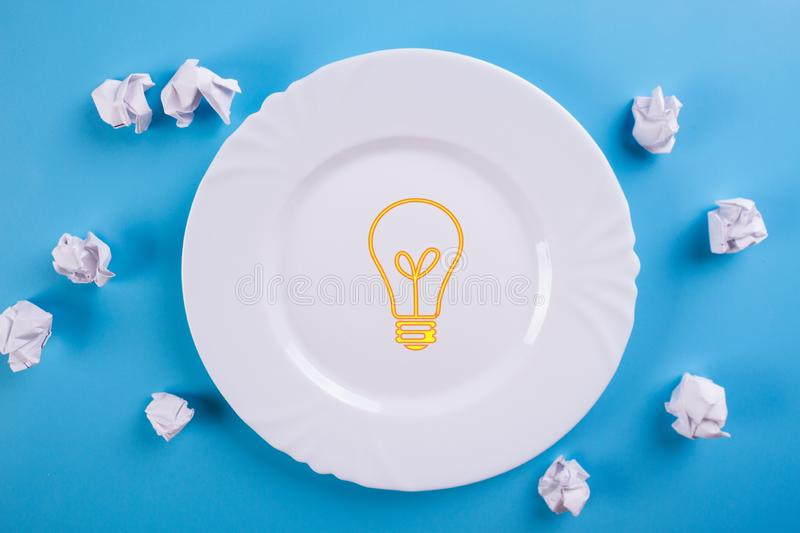 Idea Concepts Light Bulb with Crumpled Paper. On Blue background stock images
