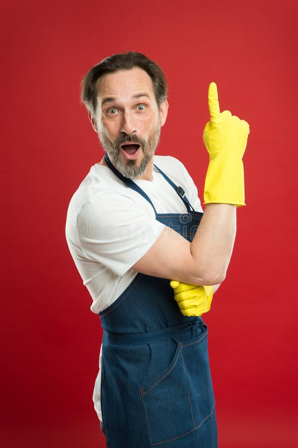 Idea for easy cleaning. Bearded guy cleaning home. Bearded worker. On guard of cleanliness. Cleaning service and. Household duty. Lot of work. Man in apron with stock photo