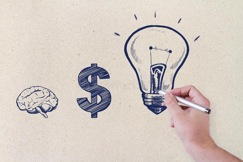 Idea and finance concept. Male hand drawing creative business sketch on concrete wall background. Idea and finance concept stock images