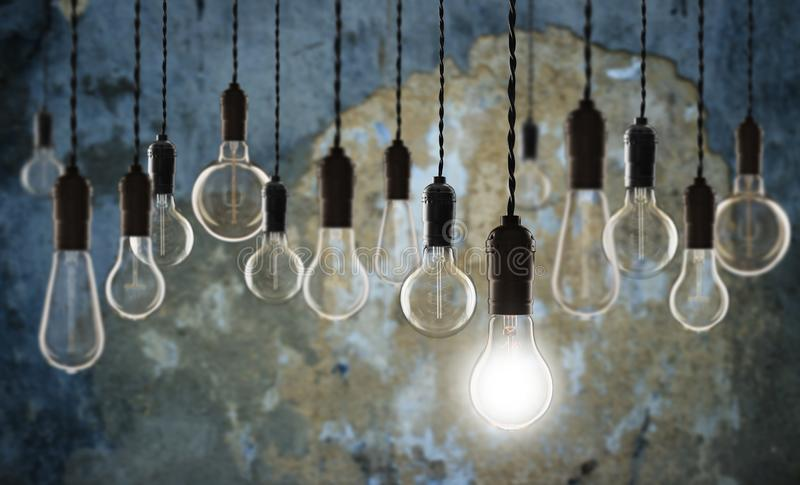 Idea and leadership concept - bulbs on the grunge background. Idea and leadership concept - Vintage bulbs on the grunge background bright conceptual creative stock images