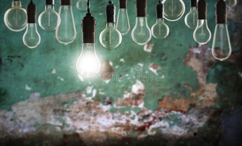 Idea and leadership concept - bulbs on the grunge background. Idea and leadership concept - Vintage bulbs on the grunge background bright conceptual creative royalty free stock image