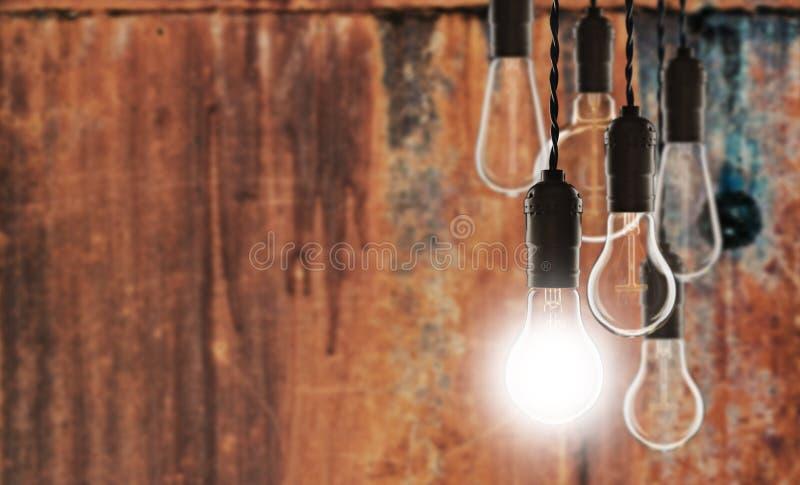 Idea and leadership concept - bulbs on the grunge background. Idea and leadership concept - Vintage bulbs on the grunge background bright conceptual creative stock photos