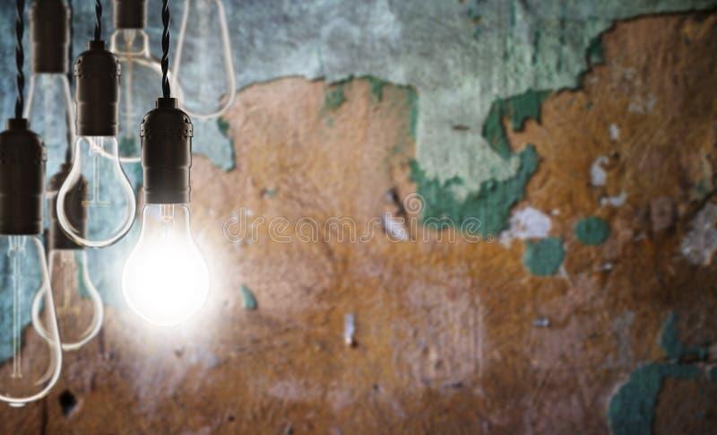 Idea and leadership concept - bulbs on the grunge background. Idea and leadership concept - Vintage bulbs on the grunge background, bright, conceptual, creative stock photo