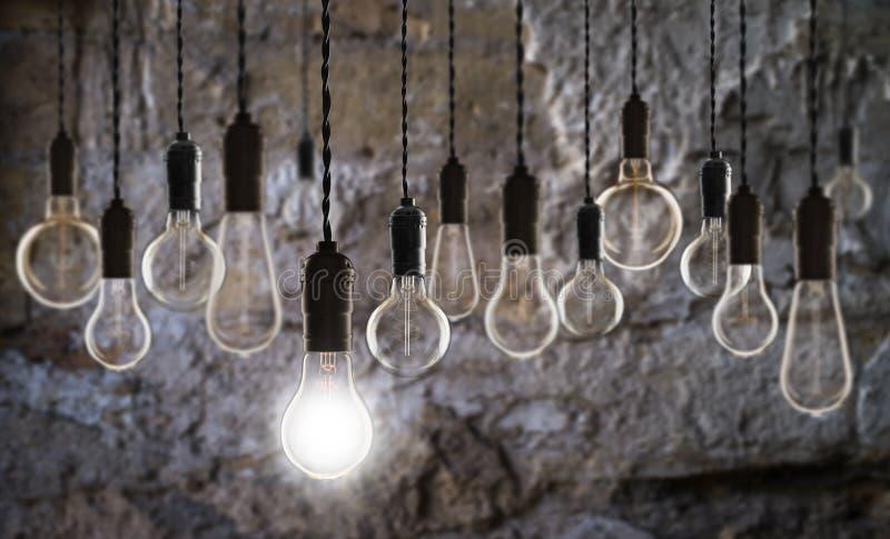 Idea and leadership concept - bulbs on the grunge background. Idea and leadership concept - Vintage bulbs on the grunge background, bright, conceptual, creative stock photography
