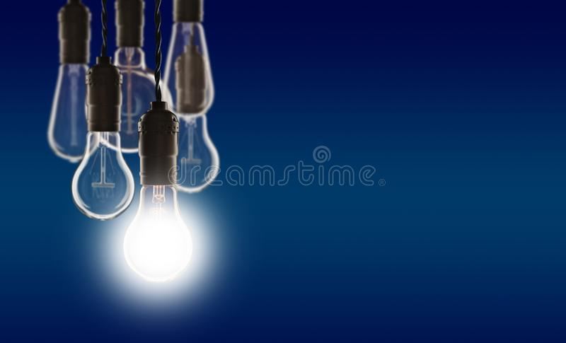 Idea and leadership concept - bulbs on the grunge background. Idea and leadership concept - Vintage bulbs on the color background bright conceptual creative royalty free stock photography