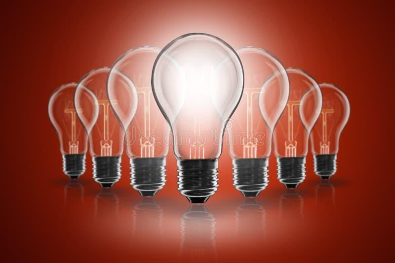 Idea concept - light bulb on the color background. Idea and leadership concept - incandescent light bulb on the color background royalty free stock images
