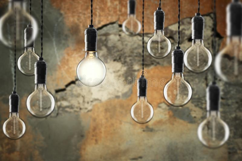 Idea and leadership concept Vintage incandescent Edison bulbs on color background. Idea and leadership concept Vintage incandescent Edison type bulbs on color royalty free stock image