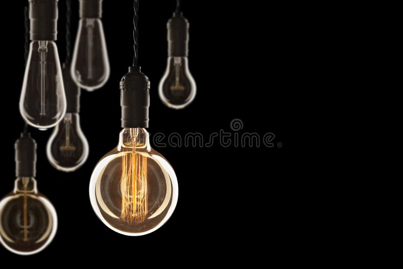 Idea and leadership concept Vintage incandescent Edison bulbs on. Idea and leadership concept Vintage incandescent Edison type bulbs on color wall stock images