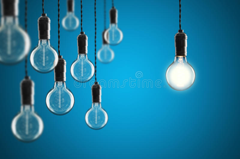 Idea and leadership concept Vintage incandescent Edison bulbs on. Idea and leadership concept Vintage incandescent Edison type bulbs on color wall stock photo
