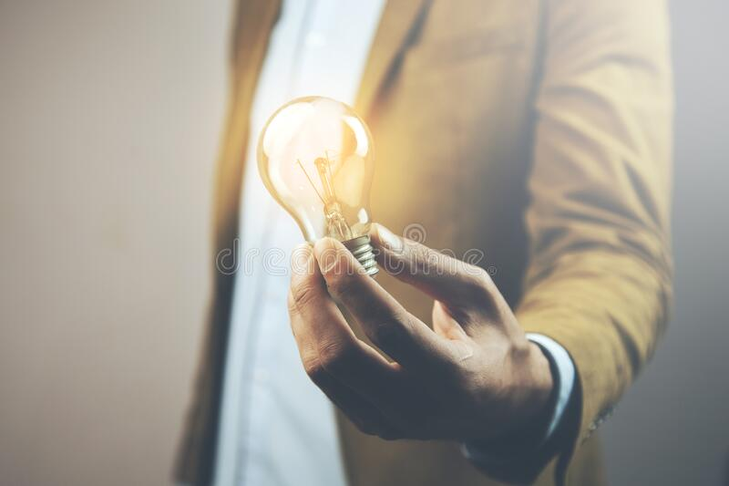 Idea or light bulb on man hand.  stock images