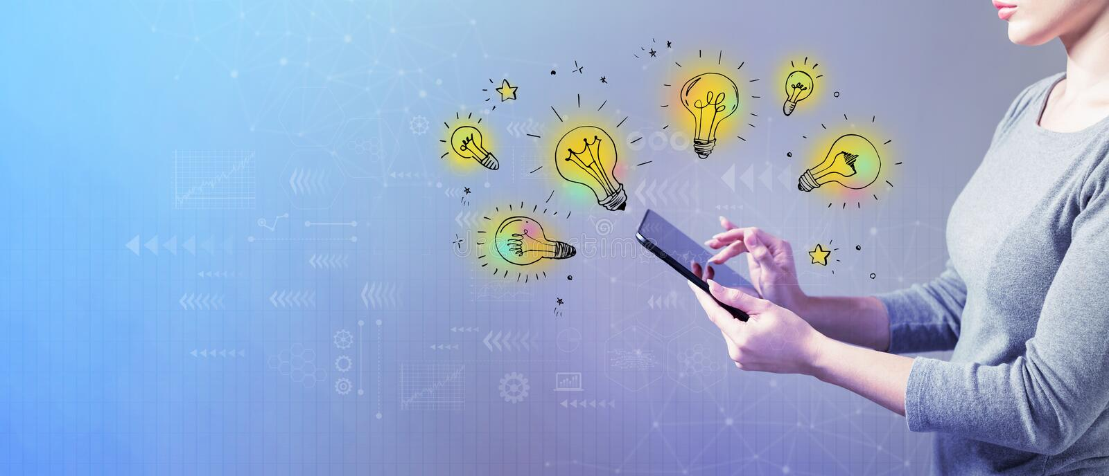 Idea light bulbs with woman using a tablet. Idea light bulbs with business woman using a tablet computer stock photo